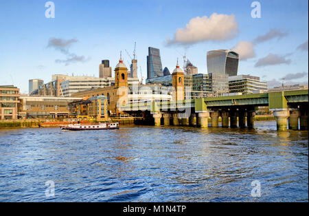 London, England, UK. Cannon Street Rail Bridge and station - The City skyline behind - Stock Photo