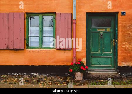 City center street in Copenhagen, Denmark - September, 22th, 2015. Orange house wall, opened windows, green rusty - Stock Photo