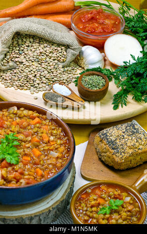 vertical image of lentil and carrot soup home made from organic ingredients  fresh food in the background copy space - Stock Photo