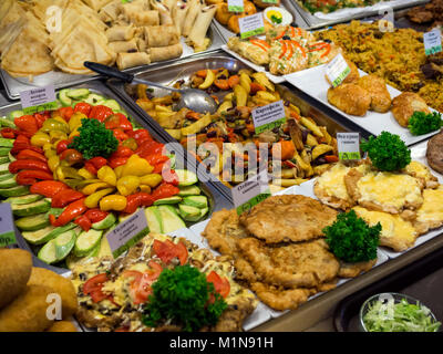 Large assortment of dishes on the counter dining room - Stock Photo