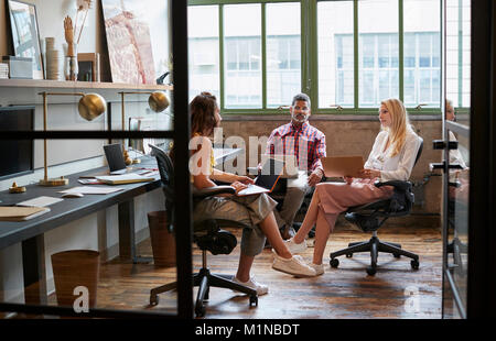 Business team meeting in an office booth, close up - Stock Photo