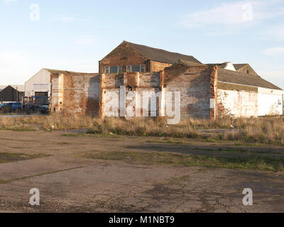 What's left of an old warehouse on Grimsby docks - Stock Photo