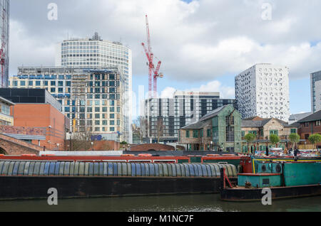 Narrowboats moored on Gas Street Basin in the centre of the canal network in Birmingham, UK - Stock Photo