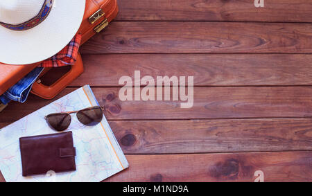 Men's casual outfits with man clothing, travel preparations and accessories on wooden background - Stock Photo