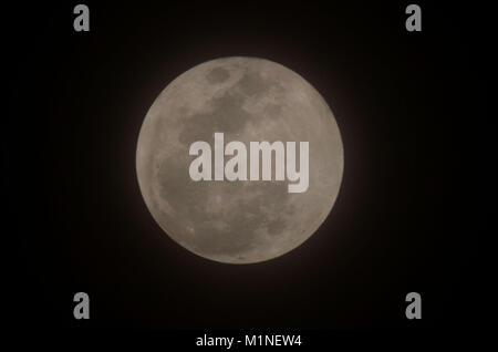 """Lahore, Pakistan. 01st Feb, 2018. A view of the rare """"Super Blue Blood Moon"""" sighted in the provincial capital. - Stock Photo"""