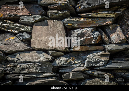 The stones are stacked on top of each other and form a wall. - Stock Photo