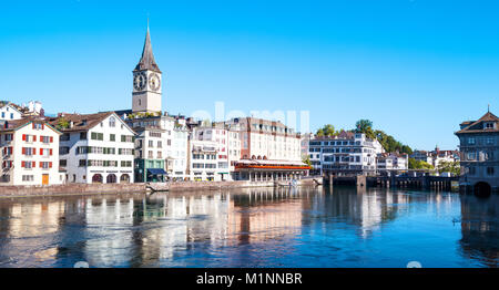 Zurich, Switzerland, View of the city center on the Limmat river with the St. Peter bell tower in the background - Stock Photo