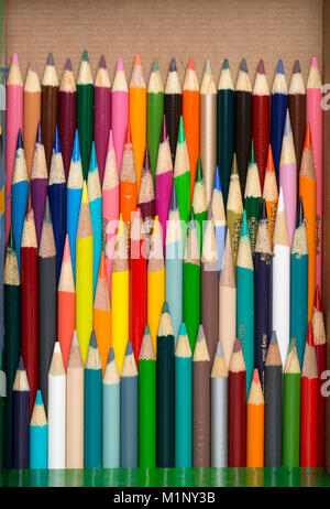 A box of used color pencils at various lengths and colors - Stock Photo