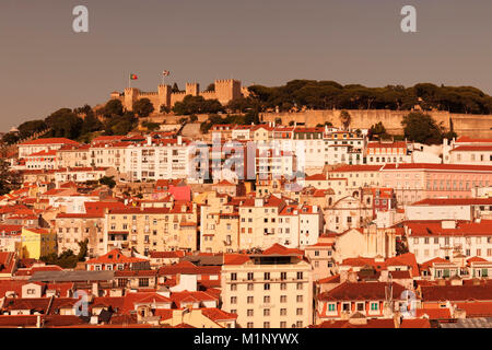 View over the old town to Castelo de Sao Jorge castle at sunset, Lisbon, Portugal, Europe - Stock Photo