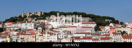 View over the old town to Castelo de Sao Jorge castle, Lisbon, Portugal, Europe - Stock Photo