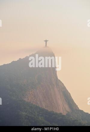 Christ the Redeemer and Corcovado Mountain at sunrise, Rio de Janeiro, Brazil, South America - Stock Photo