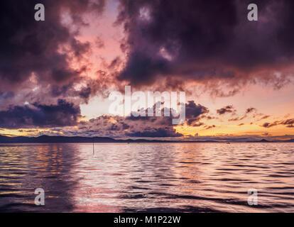 Lake Titicaca at sunrise, Uros Floating Islands, Puno Region, Peru, South America - Stock Photo