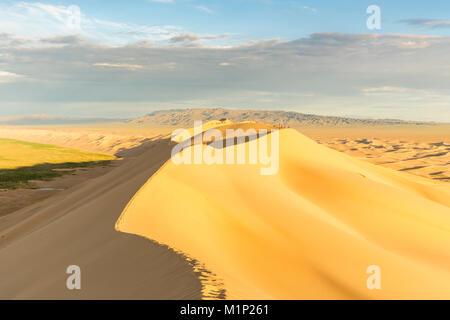 People walking on Khongor sand dunes in Gobi Gurvan Saikhan National Park, Sevrei district, South Gobi province, - Stock Photo