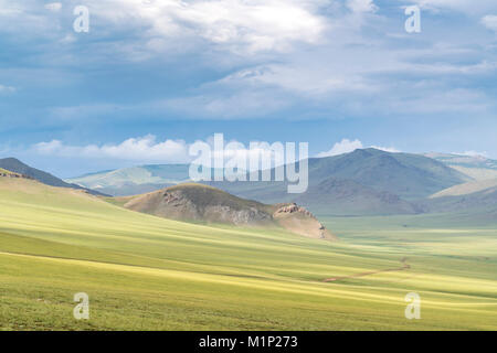 Landscape of the green Mongolian steppe under a gloomy sky, Ovorkhangai province, Mongolia, Central Asia, Asia - Stock Photo
