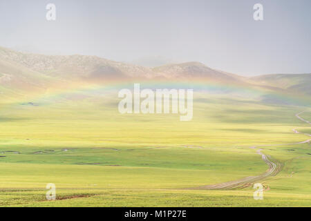 Rainbow over the green Mongolian steppe, Ovorkhangai province, Mongolia, Central Asia, Asia - Stock Photo