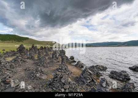 Volcanic rock formations on the shores of White Lake, Tariat district, North Hangay province, Mongolia, Central - Stock Photo