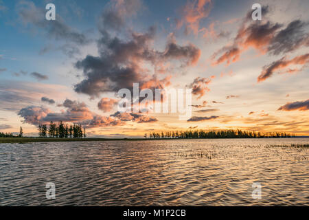 Fir trees and clouds reflecting on the suface of Hovsgol Lake at sunset, Hovsgol province, Mongolia, Central Asia, - Stock Photo