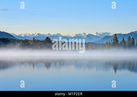 Autumn morning,with early morning fog at the Kirchsee,near Sachsenkam,alpine panorama with Karwendel Mountains,Upper - Stock Photo