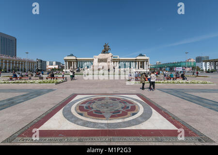 Tourists in Sukhbaatar square with Damdin Sukhbaatar statue, Ulan Bator, Mongolia, Central Asia, Asia - Stock Photo