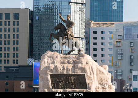 Damdin Sukhbaatar statue with skyscrapers in the background, Ulan Bator, Mongolia, Central Asia, Asia - Stock Photo