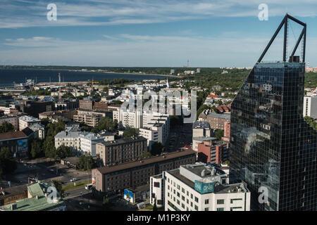 Cityscape of modern buildings and Baltic Sea, Tallinn, Estonia, Europe - Stock Photo