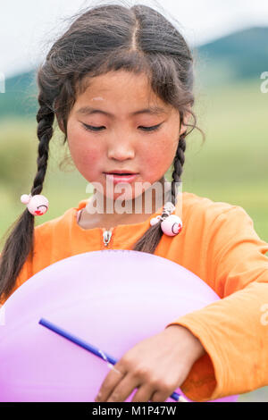 Portrait of a Mongolian Nomadic girl with braids, North Hangay province, Mongolia, Central Asia, Asia Stock Photo