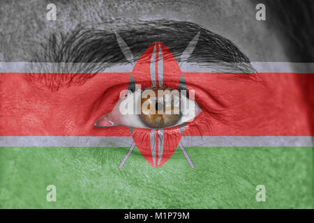 Human face and eye painted with flag of Kenya - Stock Photo