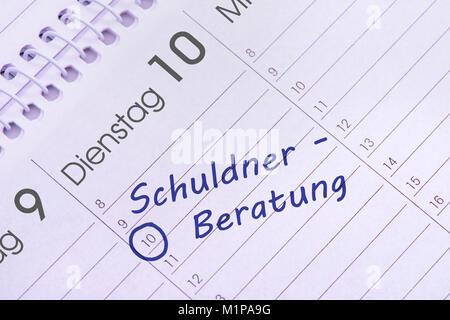 Schuldnerberatung Termin im Kalender - Stock Photo
