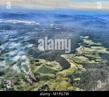 Crops burning in a deforested area in the coastal range near Cairns, Far North Queensland, FNQ, QLD, Australia - Stock Photo