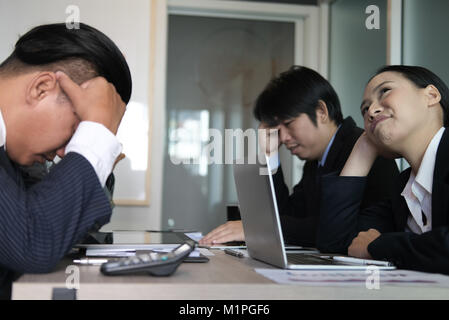 bored businesswoman lean head on hand at meeting. unhappy businessman at conference. sad colleagues at office. business - Stock Photo
