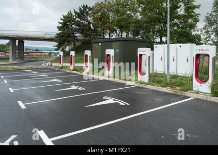 Charging station for Teslabilar, France. - Stock Photo