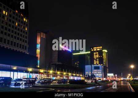 Nagaworld casino in central phnom penh city street cambodia at night - Stock Photo