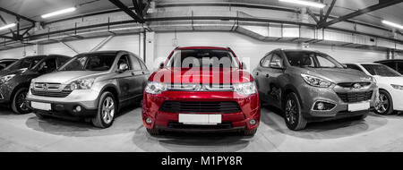 Novosibirsk, Russia - February 12, 2017:  in the car showroom are rows of city crossovers for sale: Mitsubishi,Honda, - Stock Photo
