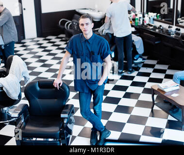 Barber on the chair. Barber expects the client to sit in the chair. - Stock Photo