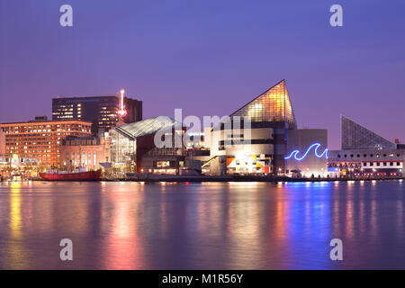 Baltimore, Maryland, USA - VIew at night of the National Aquarium at Inner Harbor. - Stock Photo