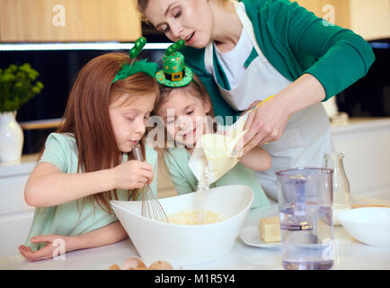 Mother with children making cookies - Stock Photo