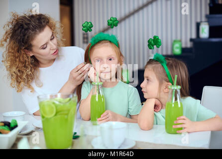 Mother with children spending time at kitchen - Stock Photo