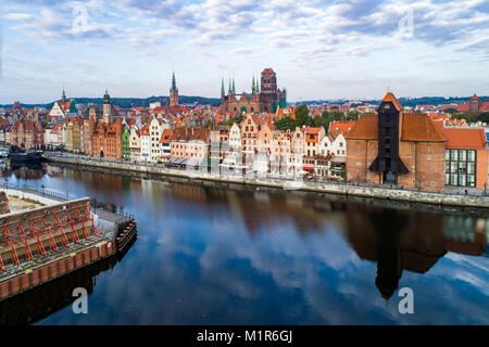 Gdansk old city in Poland with the oldest medieval port crane (Zuraw) in Europe, St Mary church, Town hall tower - Stock Photo