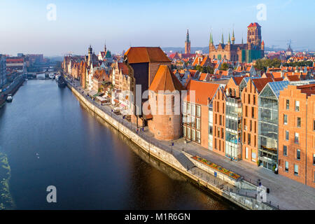 Gdansk old city in Poland with the oldest medieval port crane (Zuraw) in Europe, St Mary church, Town hall tower, - Stock Photo