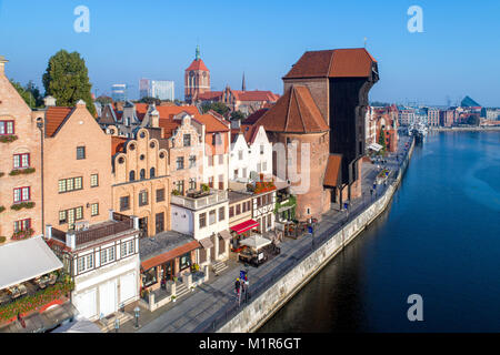 Gdansk old city in Poland with the oldest medieval port crane (Zuraw) in Europe, St John church and Motlawa River - Stock Photo