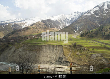 The Georgian Military Highway in springtime, along the Aragvi river in Georgia approaching the high Caucasus mountains,towards - Stock Photo