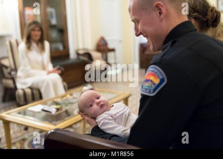 Albuquerque Police Officer Ryan Holets holds his adopted baby girl, Hope, as U.S First Lady Melania Trump hosts - Stock Photo