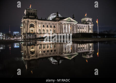 Berlin, Germany. 1st Feb, 2018. The German Reichstag reflects itself in a rain puddle in Berlin, Germany, 1 February - Stock Photo