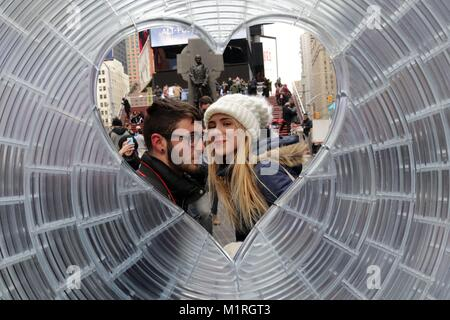 New York, New York, USA. 1st Feb, 2018. A couple about to kiss. Times Square Arts has unveiled the winner of the - Stock Photo