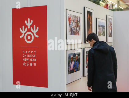 Berlin, Germany. 1st Feb, 2018. A man watches photos displayed during a series of cultural celebrations 'Happy Chinese - Stock Photo