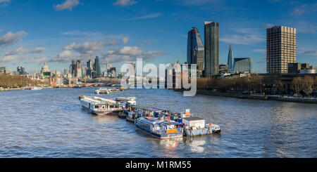 View of the City of London Skyline across the River Thames from Waterloo Bridge on a bright sunny day. - Stock Photo