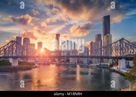 Brisbane. Cityscape image of Brisbane skyline, Australia with Story Bridge during dramatic sunset. - Stock Photo