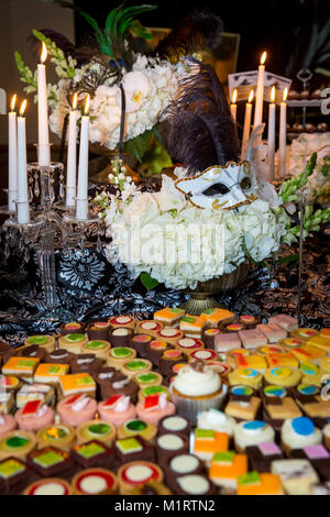Deserts and decor at a Venice-inspired buffet dinner, Naples, Florida, USA - Stock Photo