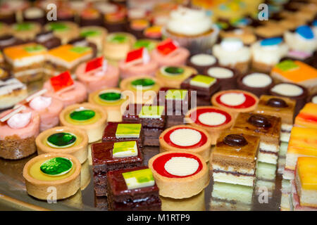 Miniature cakes on a tray at a desert station at a dinner party buffet, Naples, Florida, USA - Stock Photo