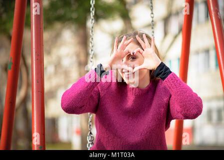 Young woman sending love - Stock Photo
